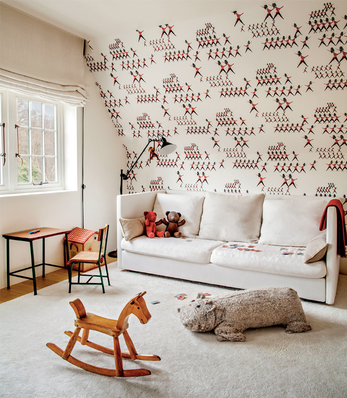 Cutest kids room. And it is really just plan room with cool wall covering on one wall and some pops of color. This is a lesson in fun restraint.