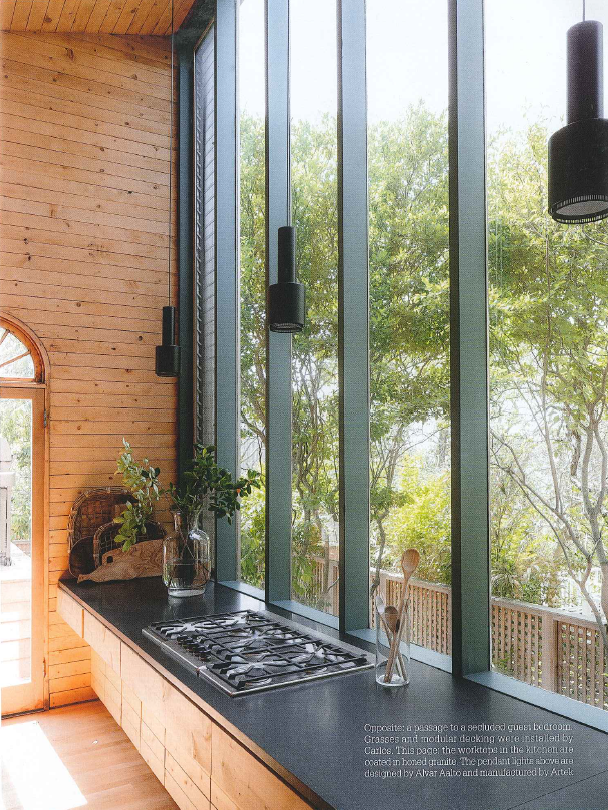 Beach kitchens should be simple and geared towards entertaining. I love the Alavor Aalto pendant lights through Artek.