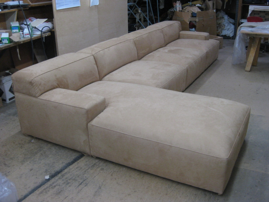 I love the massive scale of this sofa: wide arms and back, deep upholstered seat.