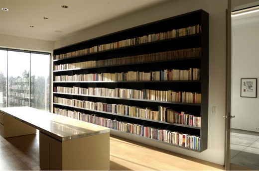 Floating metal bookcase, minimal like Donald Judd furniture, and equally proportioned top and bottom