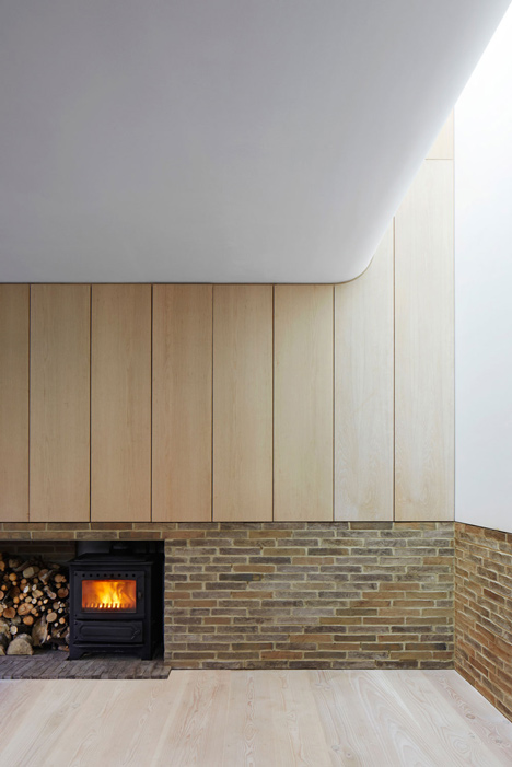 Basement fireplace by Piercy and Company.
