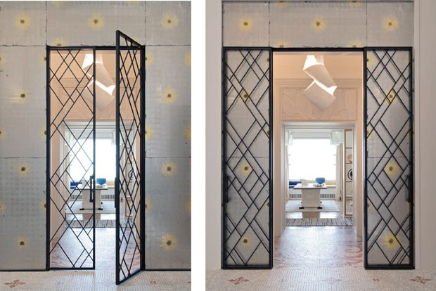 Doors leading into a room by Carline Sarkozy and Laurent Bourgois.