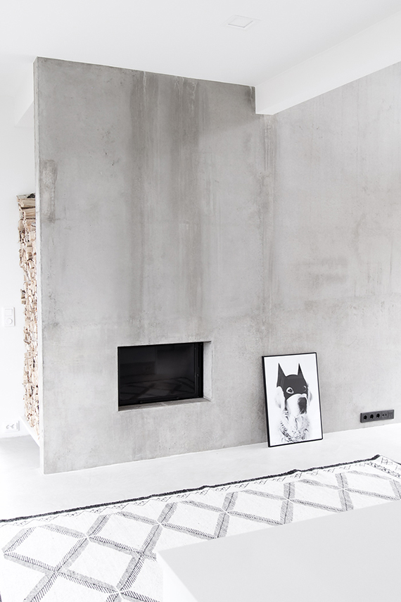 A minimal fireplace in a Scandinavian home.