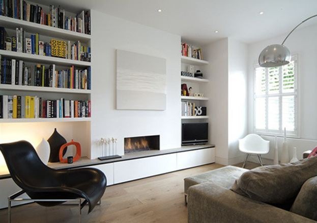 Integrating book shelves into the architecture make rooms appear larger.