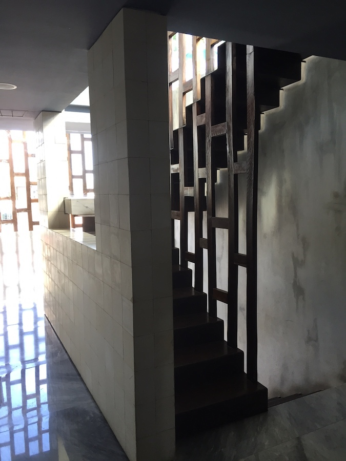 Unglazed tile contrast with the polished floor in this open-air internal staircase at Be Playa Hotel.