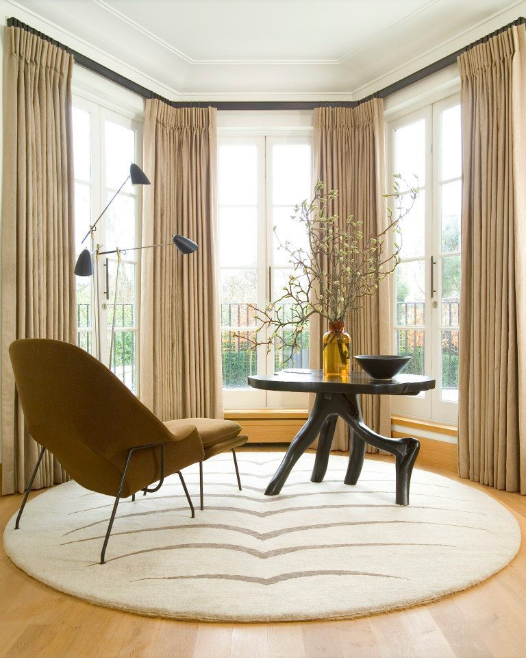 A reading alcove with Saarinen chair, Royere light and custom organic table.