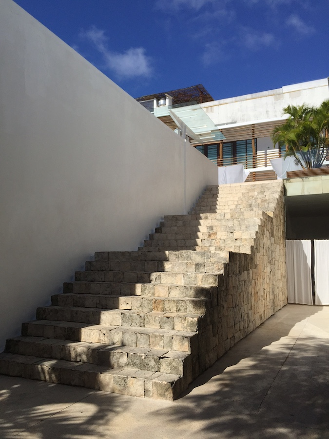 Plaster walls contrast with the local stone stairs in this building in Play del Carmen.