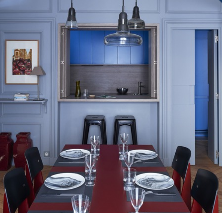 Bold Corbusian colors in this dining room and kitchen  by Studio deSigy in Paris.