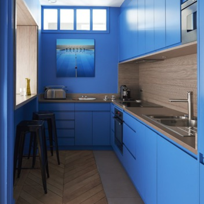 Bold use of Cerulean blue in this kitchen by Studio deSigy in Paris.
