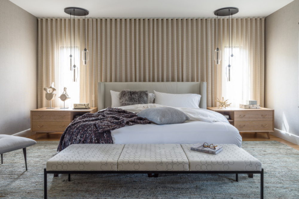 The drapery unifies the elevation of the headboard wall, and reduces the impact of the small windows.
