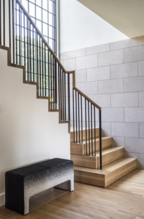 The traditional railing was replaced with a modern version in steel and oak.