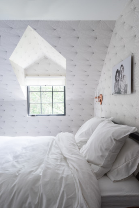 Wall covering adds interest to this traditional looking kids bedroom.