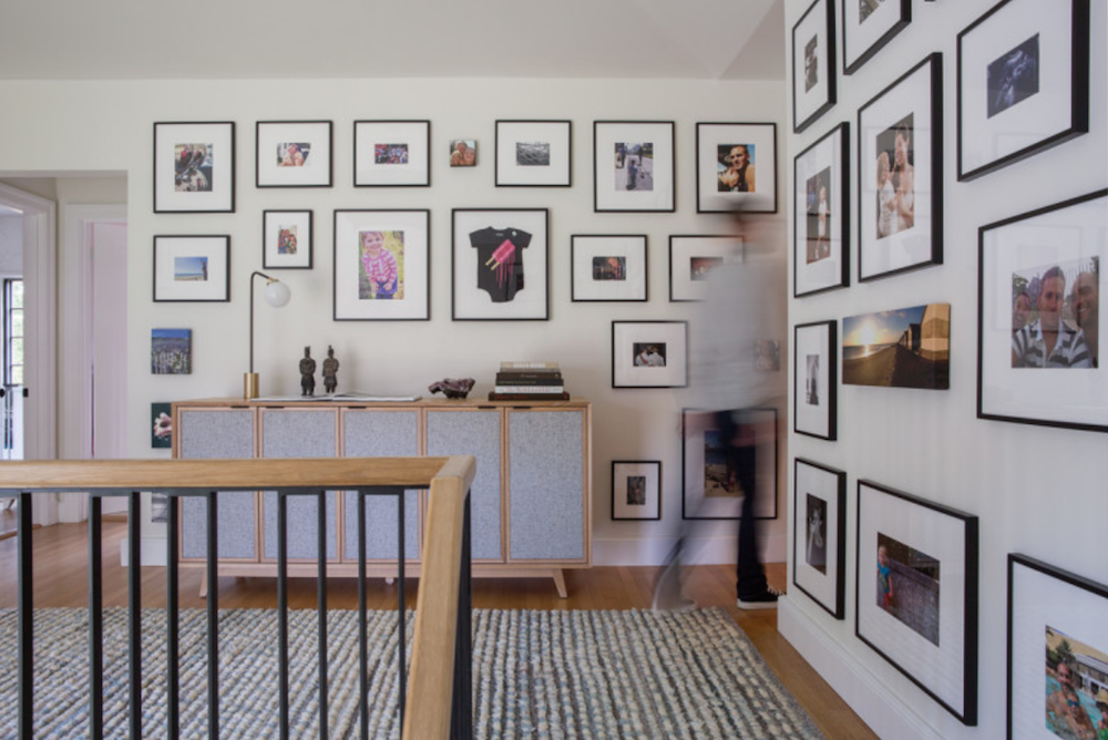 Add interest to any space with a collection of family photographs framed in a unifying way.