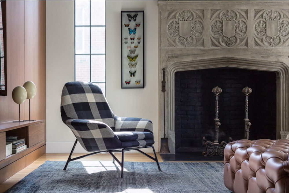 The large scale tartan on this chair adds energy and personal interest to the room.
