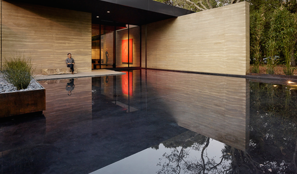 Rammed earth, steel, stone and water combine in the garden at Windhover Contemplative Center.