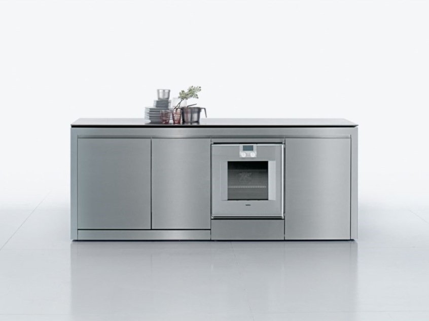 The K2 Kitchen expands when cooking and dining, as the surface conceals a cooktop.