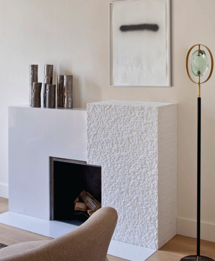 The varied texture and blocking of this fireplace adds drama and interest.