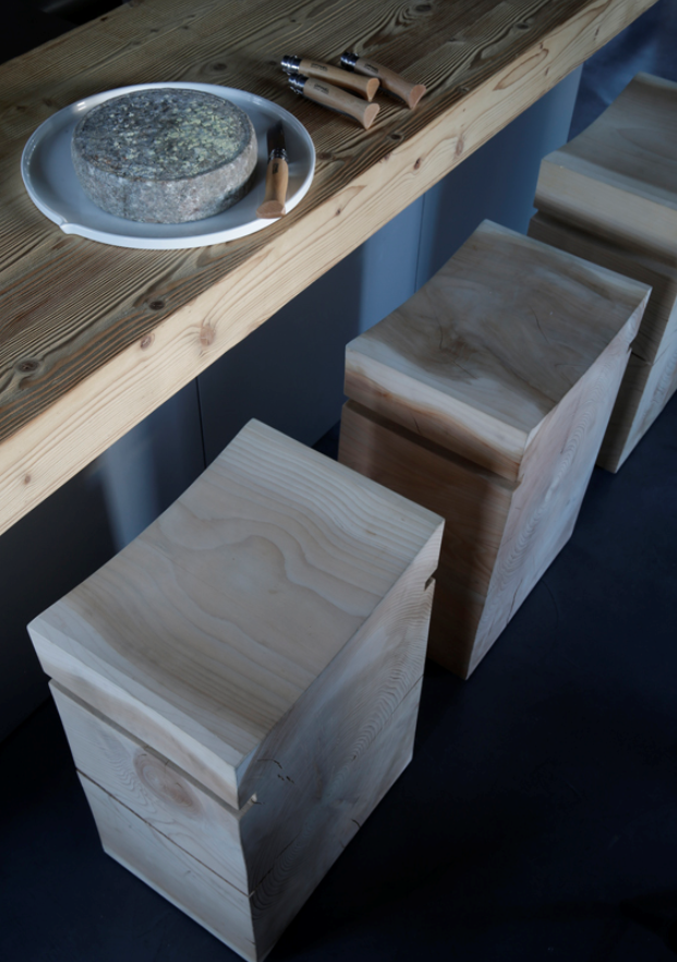 Rough countertop contrasts with the refined wood stool, #AngeliqueBuisson