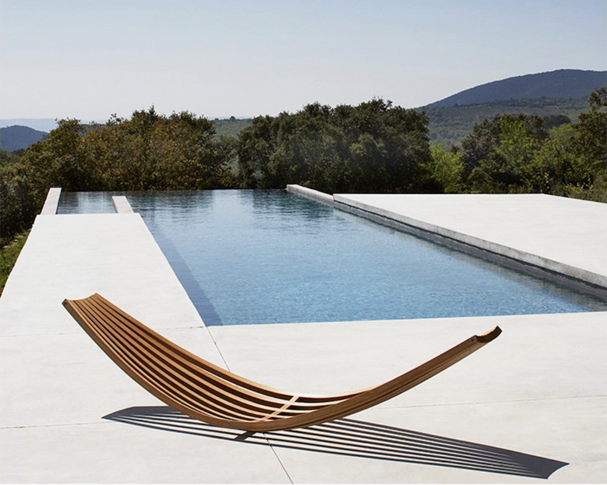 I love how amazing this simple sculptural chair looks in Villa G by Studio Ko.