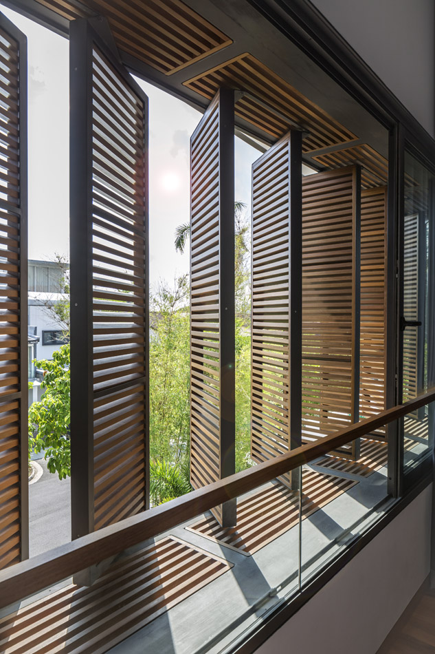 Shutters screen the light without blocking the breeze.